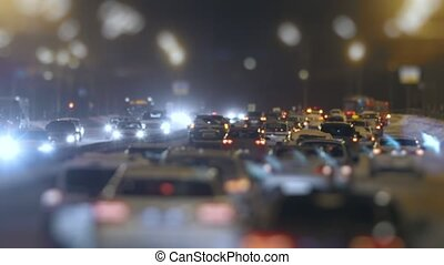 Tilt Shift shot of traffic on snow winter highway, telephoto...