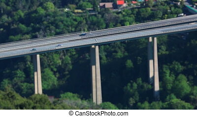 Tilt-Shift Time Lapse Of Highway Traffic On A Bridge -...