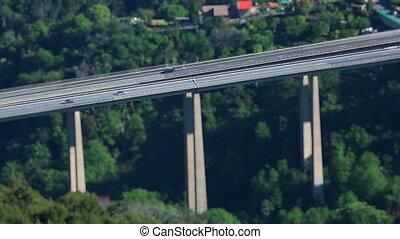Tilt-Shift Time Lapse Of Highway Traffic On A Bridge -...