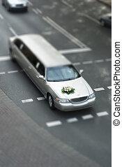 Tilt shift wedding limousine on street