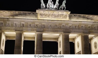Tilt up close up of the Brandenburg Gate at night, Potsdam, Germany
