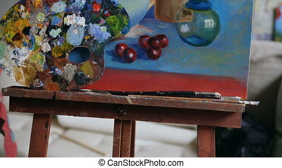 Tilt up of beautiful still life painting on canvas in art...