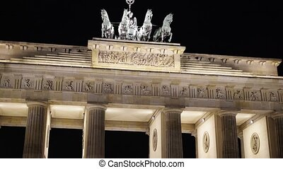 Tilt up of the Brandenburg Gate at night, Potsdam, Germany
