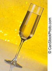 tilted flute of golden champagne