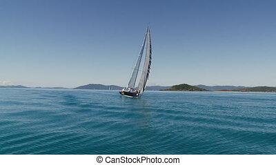 Tilted sailboat but still sailing