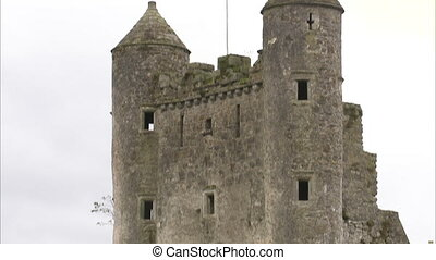 Tilting up shot of an old ruined castle in Ireland