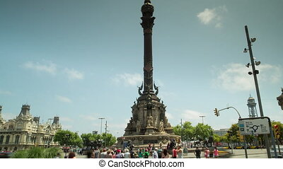 Tilting up time lapse video of people at the Colombus statue...