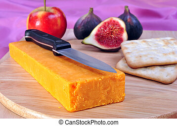 timber board with some organic cheddar cheese