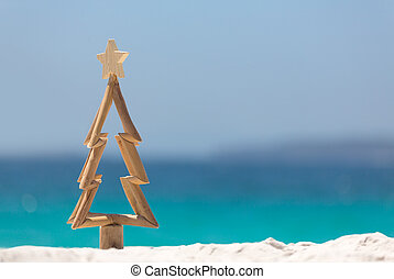 Timber Christmas tree in sand on the beach - Timber ...