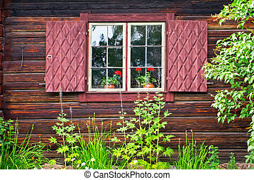 Timber cottage - Window with shutters on a swedish old hut.
