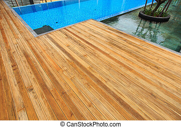 Timber decking at surrounding the pool