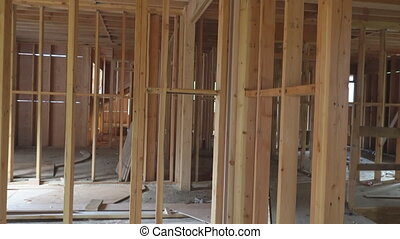 Timber frame house, stick built home under construction with...
