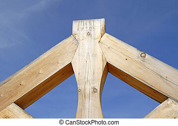 Timber Framing against Blue Sky