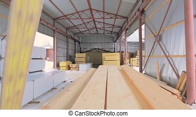Timber warehouse view with some materials ready for loading