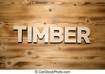 TIMBER word made with building blocks on wooden board