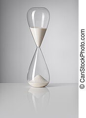 Time - A Hourglass on reflective background.