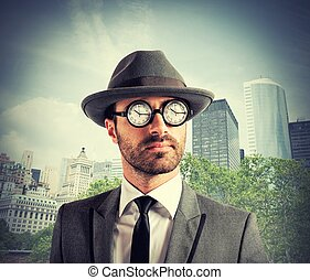 Concept of time addicted with clock on glasses of a businessman