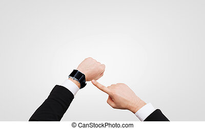 businessman pointing to smart watch at his hand