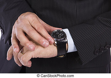 Time - Businessman checking the time on his watch
