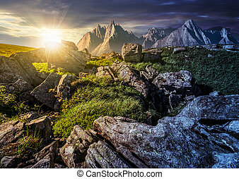 time change concept. rocky peaks and rocks on hillside in...