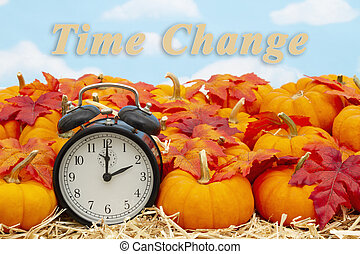 Time change message with a retro alarm clock with pumpkins and fall leaves