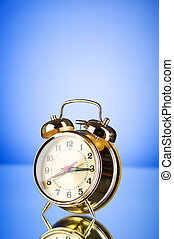 Time concept - alarm clock against colorful background
