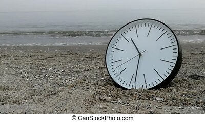 Time Concept, Clock On Sand Beach, Background Walking Man Sea Sky