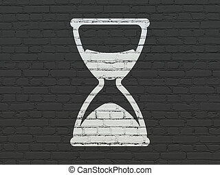 Time concept: Hourglass on wall background