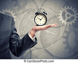Time - Concept of time with businessman that hold an alarm...