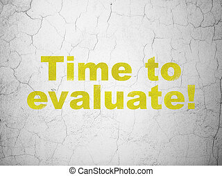 Time concept: Time to Evaluate! on wall background