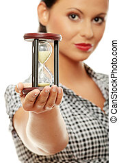 Time concept - Young business woman with hourglass - time...