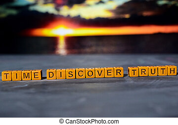 Time discovery truth on wooden blocks.