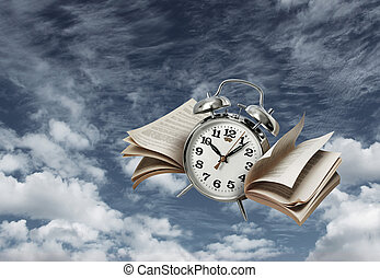 Time flies history concept - Old alarm clock flying with...