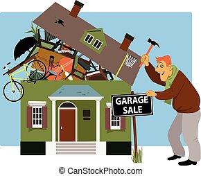 Time for a garage sale - Man putting up a garage sale sign...