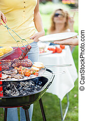 Time for barbecue in a garden