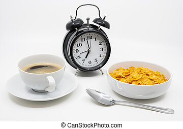 Time for breakfast concept with clock, cereal and coffee