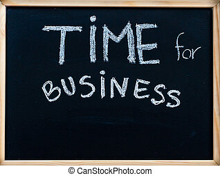 Time for business message handwritten with white chalk on wooden frame blackboard, successful business concept