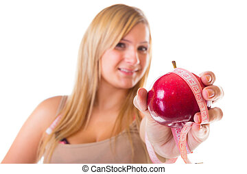 Time for diet slimming. Woman with apple and measuring tape