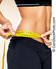 Time for diet - Woman body part is being measured