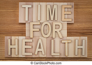 time for health -  text in vintage letters on wooden blocks. Medicine concept