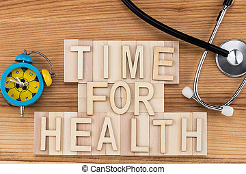 time for health -  text in vintage letters on wooden blocks with stethoscope and alarm clock. Medicine concept