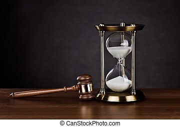 Time for Legal services - Gavel and Hourglass on dark