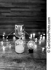 time for new ideas hourglass and lightbulb surrounded by ...