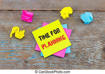 Time for planning -  on sticky note with crumpled papers on wooden background