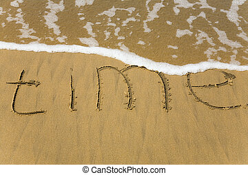 time - Handwriting word Time written  in the sand