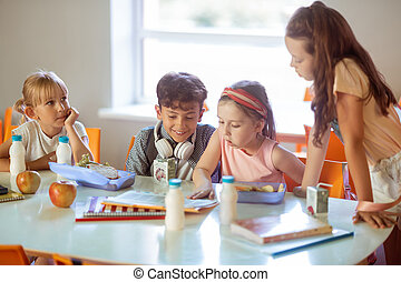 Children feeling good while spending time in canteen together