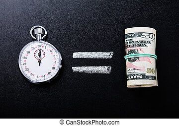 Time Is Equal To Money Concept On Blackboard - Close-up Of...