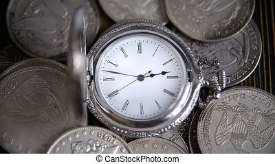 Time is money - a pocket watch on a background of...