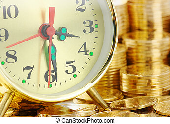 Time is money - clock dial and golden coins - Old-fashioned...