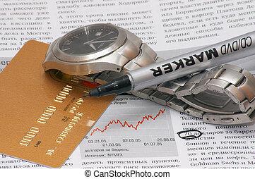 Time is money - Finance magazine, wristwatch, credit card...
